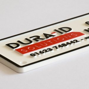Custom Moulded Nameplate with Red & Black Hot Foil Tipping